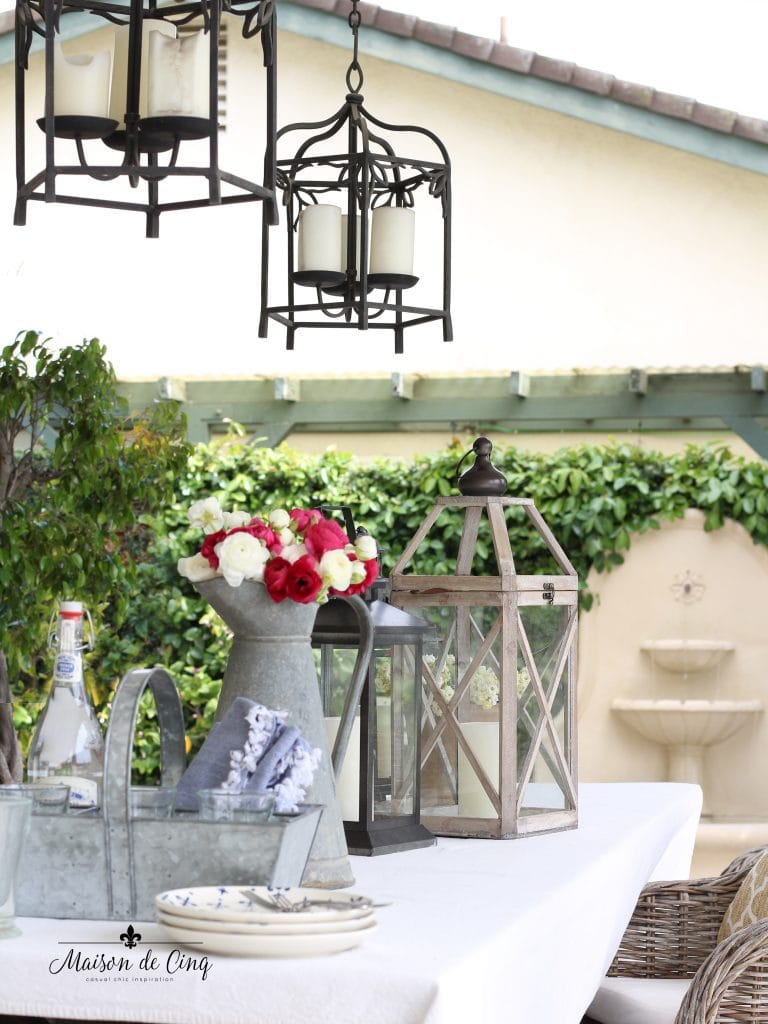 casual summer table with flowers lanterns and galvanized accessories