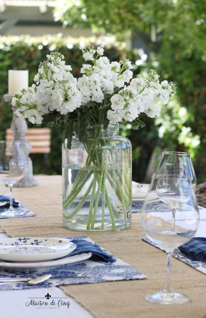 summer entertaining in the garden patio blue and white table setting white flowers