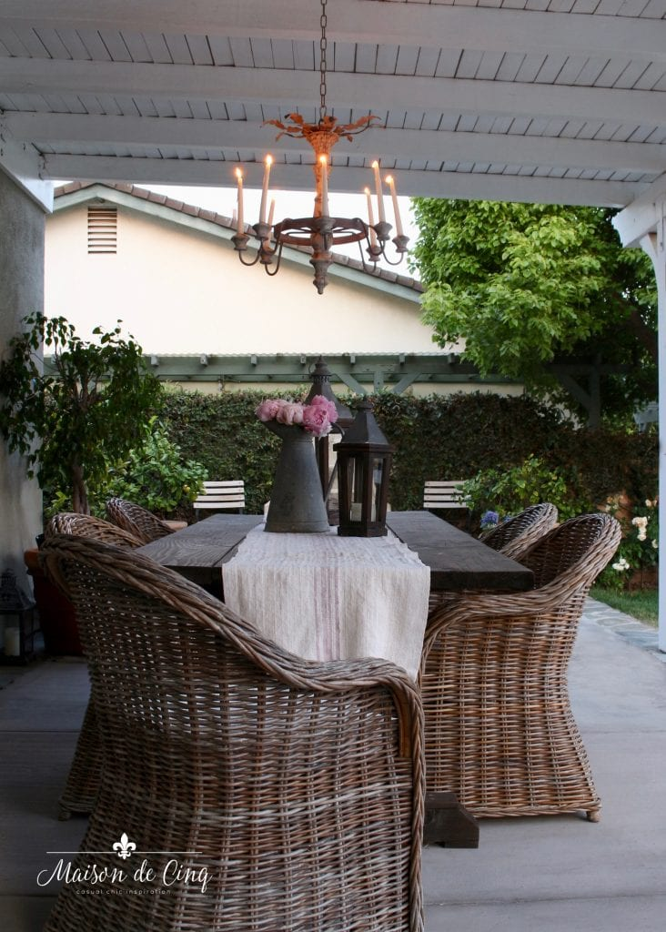 outdoor chandelier in french country patio area backyard outdoor living