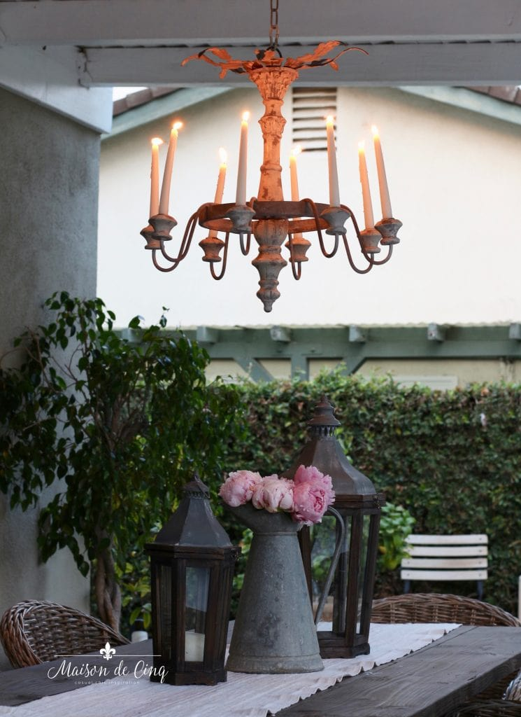 french style rustic outdoor chandelier in gorgeous backyard setting peonies lantern