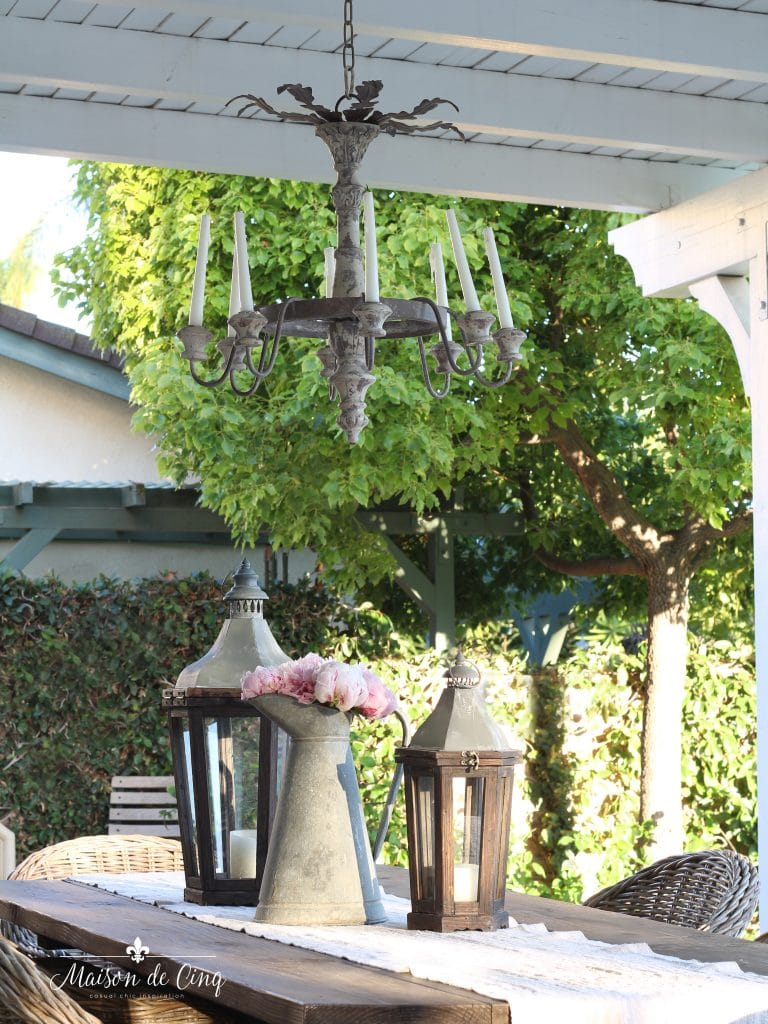 french rustic wooden style outdoor chandelier backyard garden setting