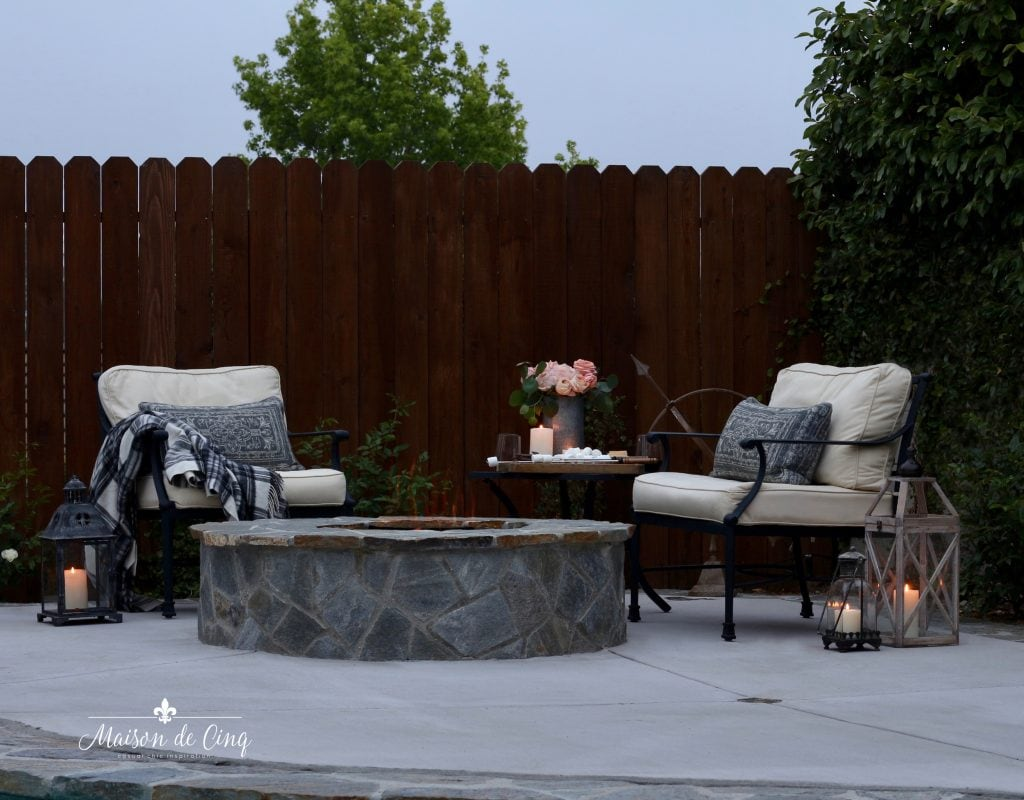 summer outdoor entertaining by the fire pit chairs lanterns candlelight
