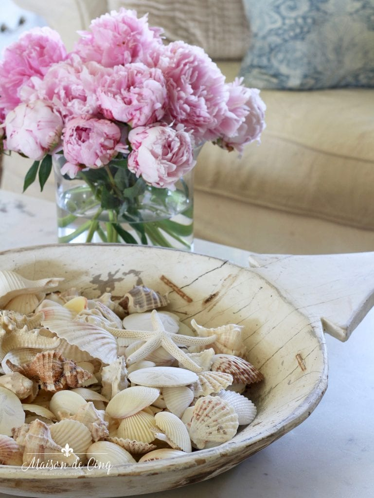 summer decorating ideas gorgeous pink peonies and shells in living room