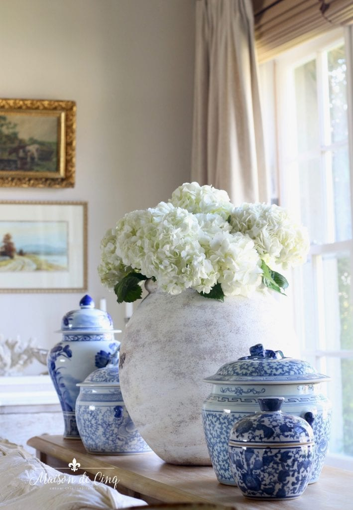 summer decorating ideas with white hydrangeas and blue and white ginger jars