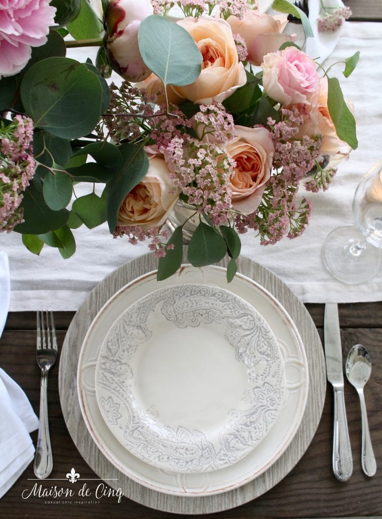 romantic summer table setting with roses and pottery barn plates