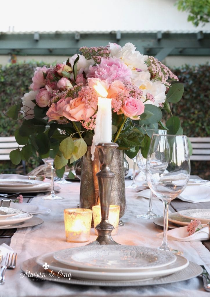 romantic summer table with pink peonies and candlelight summer entertaining ideas