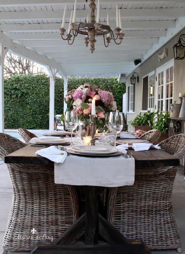 romantic summer tablescape with pink flowers linen runner and candlelight pretty patio dining