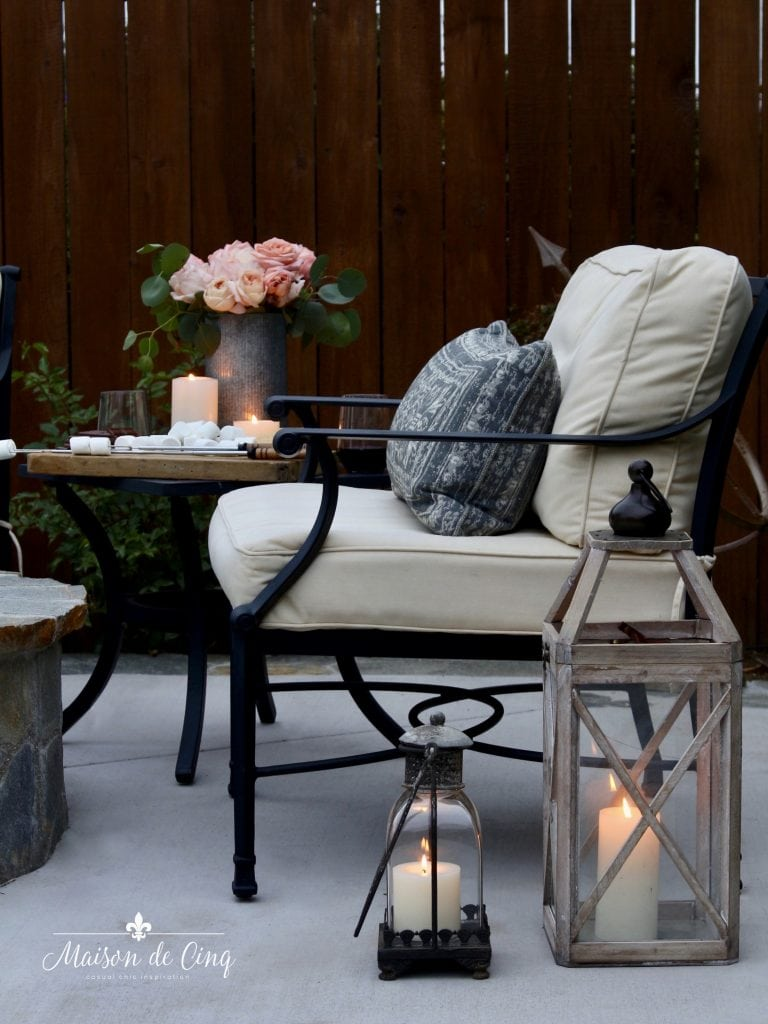 summer outdoor entertaining s'mores by the fire lanterns chair flowers