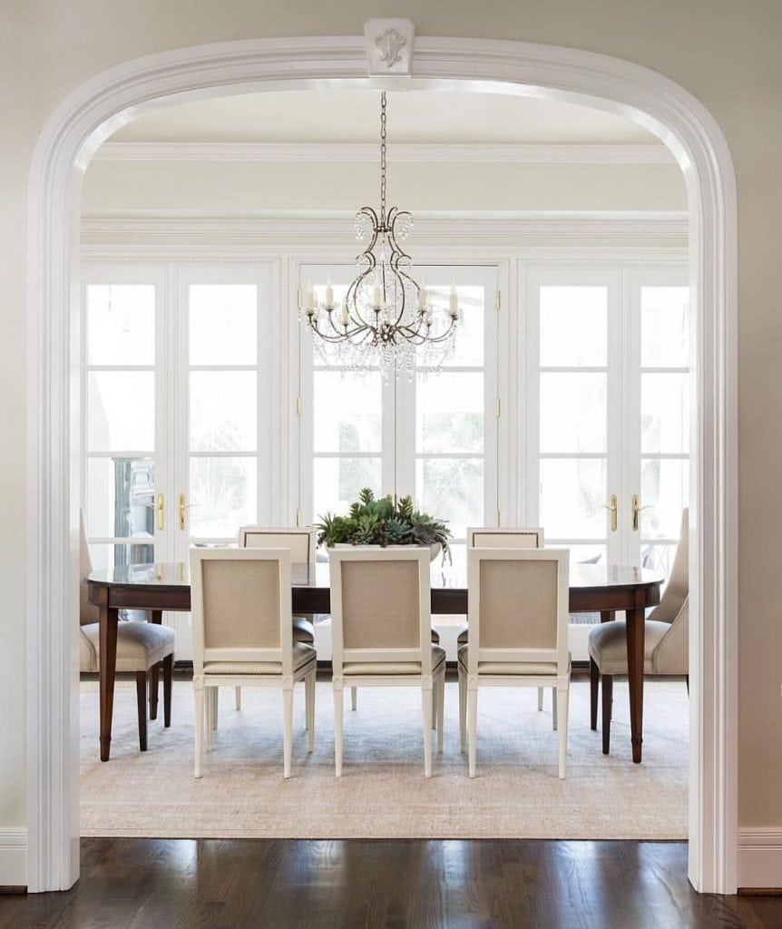 traditional dining room with mixed dining chairs crystal chandelier