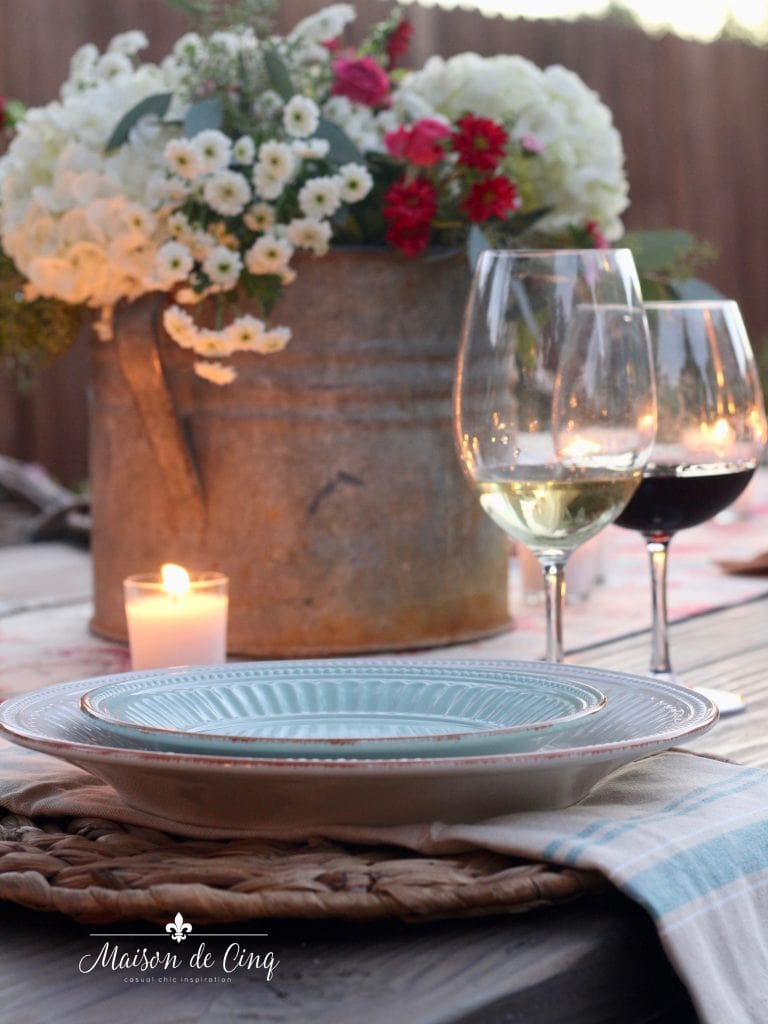 wine and candles with flowers in galvanized antique bucket summer entertaining table setting