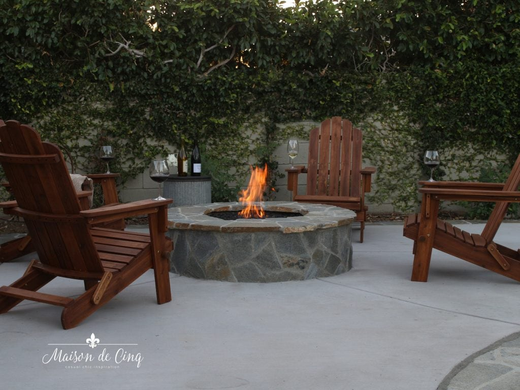 backyard flagstone fire pit with adirondack chairs