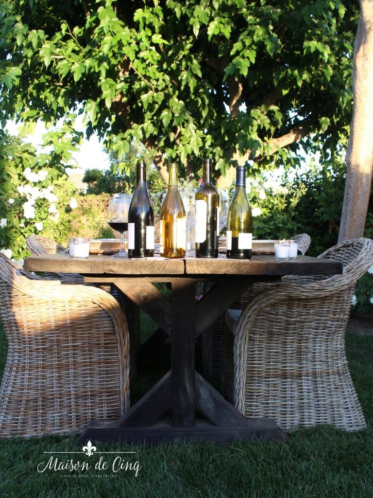 wine and cheese party in the garden wickers chairs farmhouse table backyard entertaining