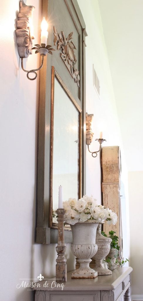 French country sconces in entry way