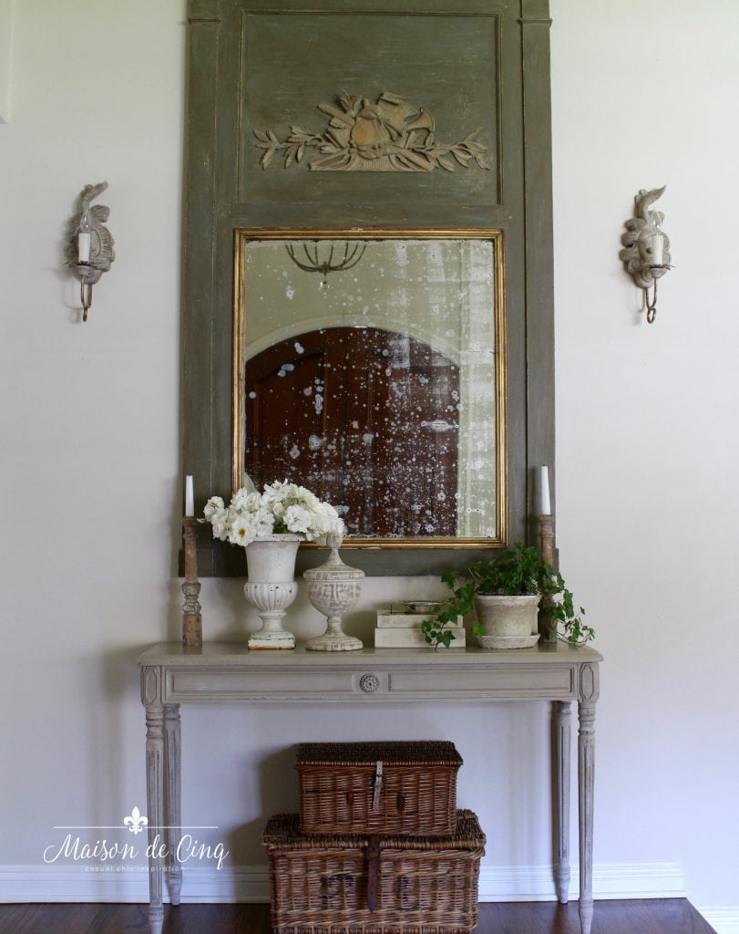 french country sconces entry way with trumeau mirror and console table