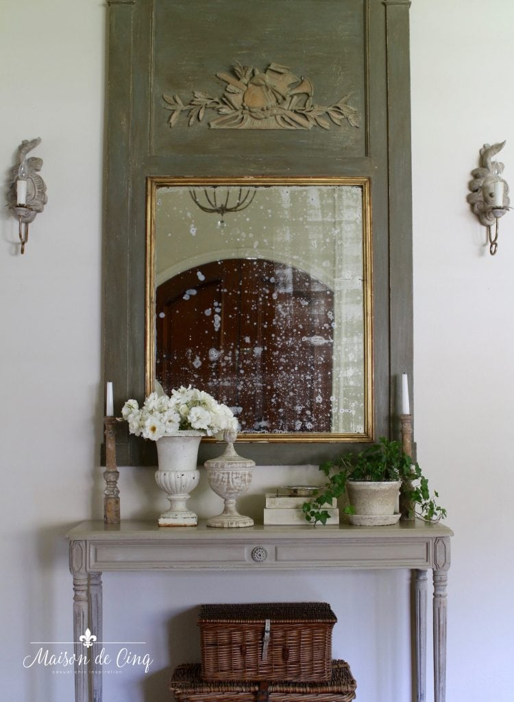 French trumeau mirror with sconces and console table baskets urns decor ideas