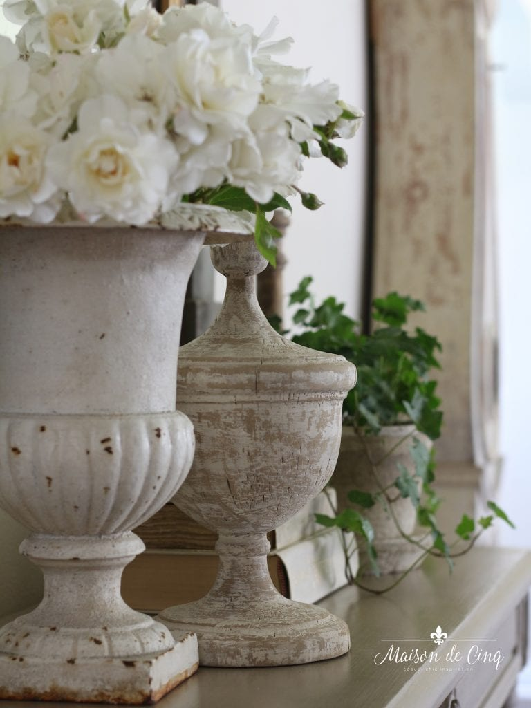 roses in antique French urn on console table gorgeous vignette