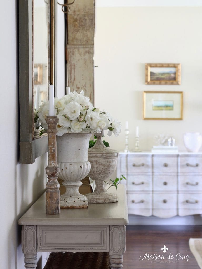 French urn with roses on console table in French country entry way gorgeous decor