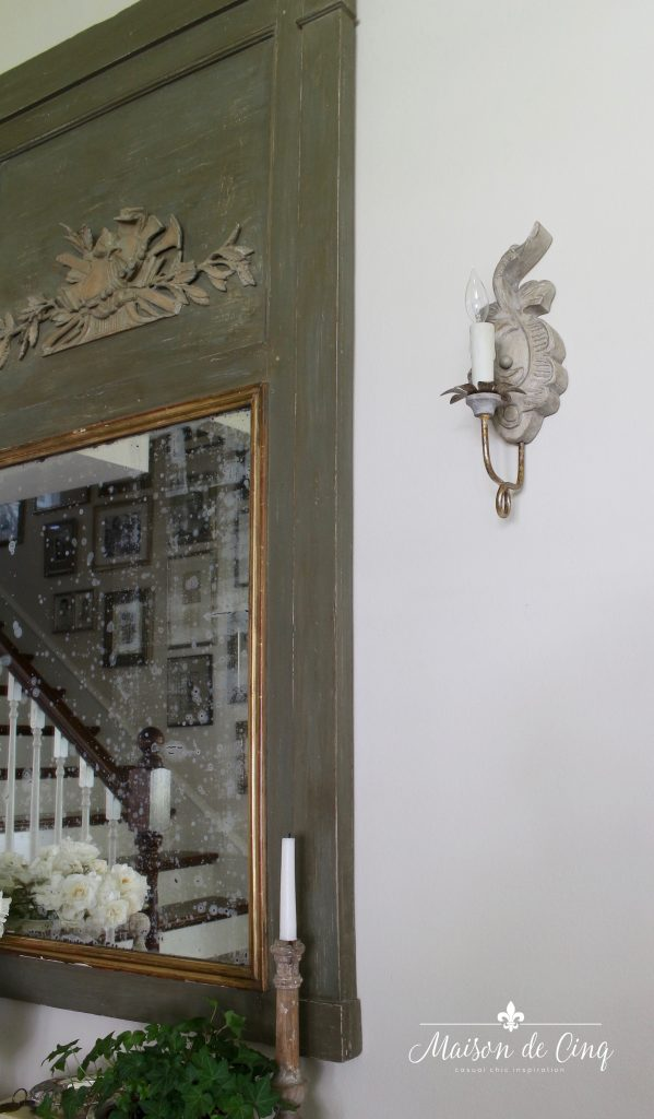 Aidan Gray Verdure French country sconce next to trumeau mirror