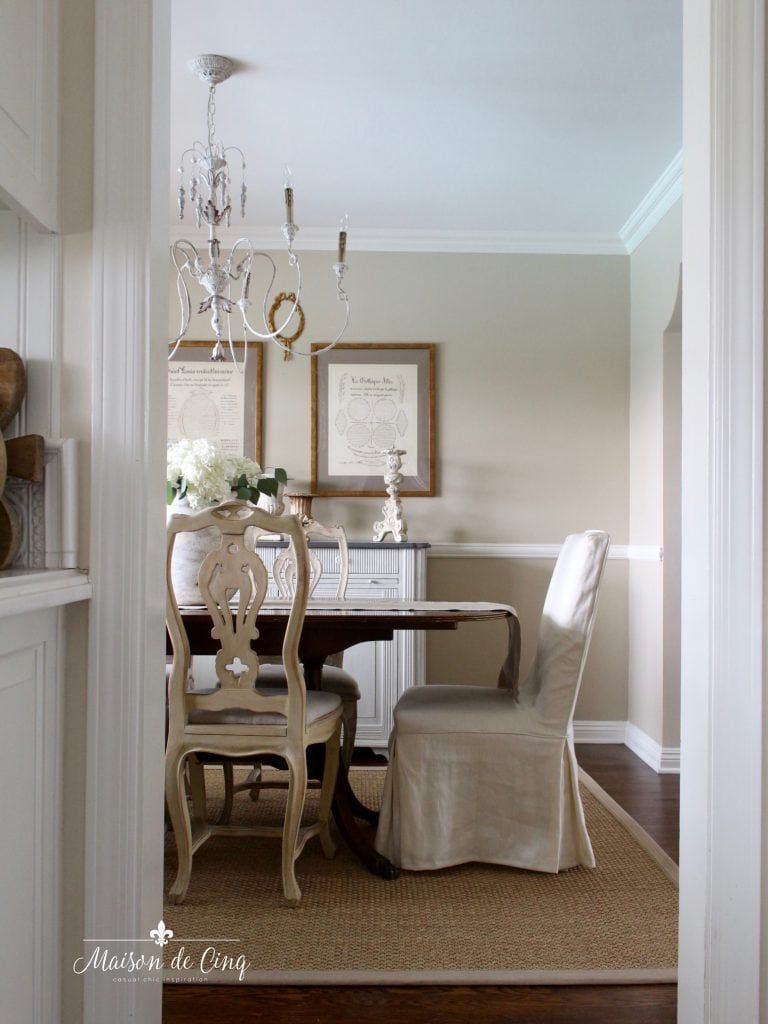 gorgeous French country farmhouse dining room with mix of dining chairs wood and slipcovered