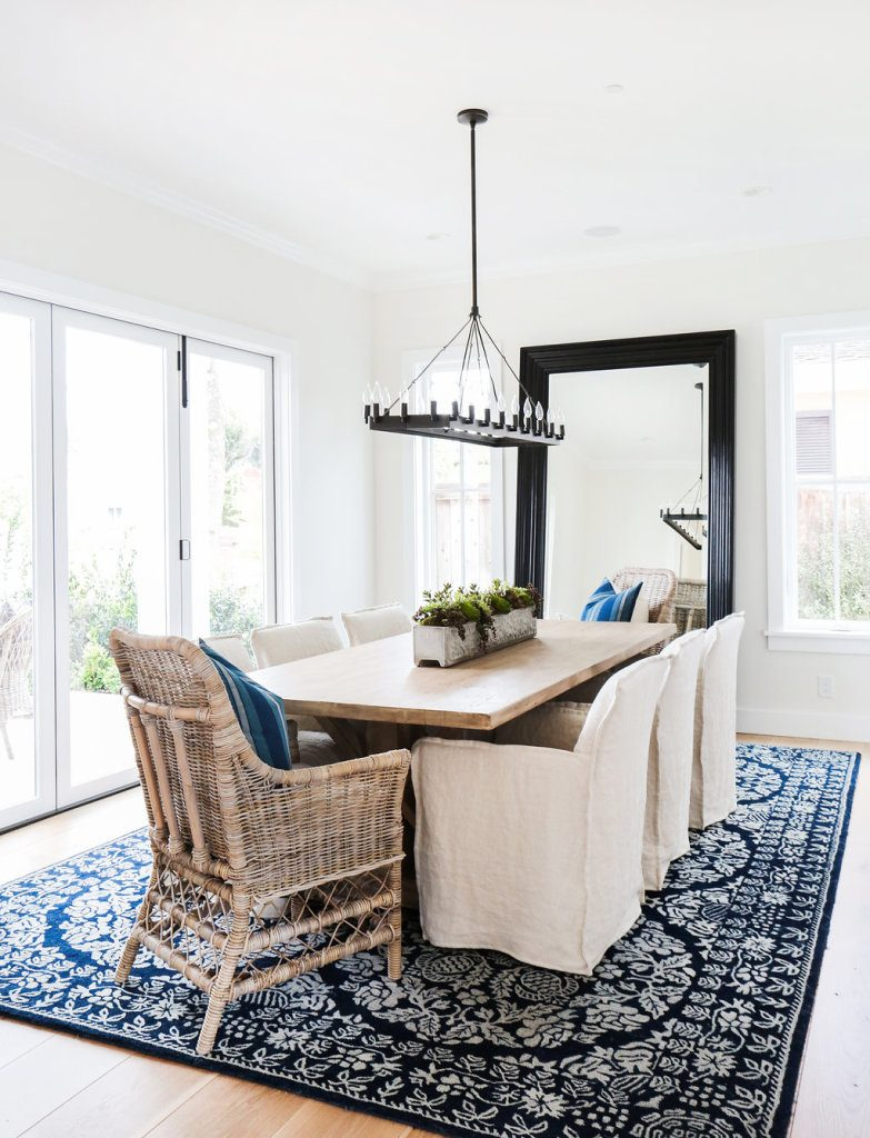 mixing dining chairs wicker end chairs with slipcovered side chairs blue and white rug transitional style room