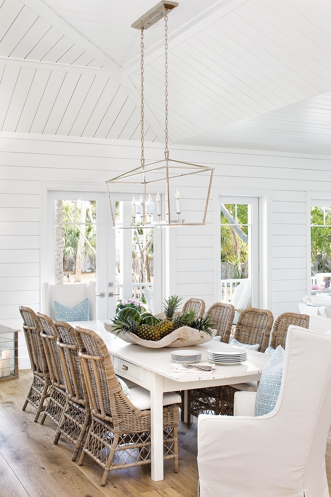 mixing dining chairs in coastal breakfast area wicker side chairs slipcovered end chairs