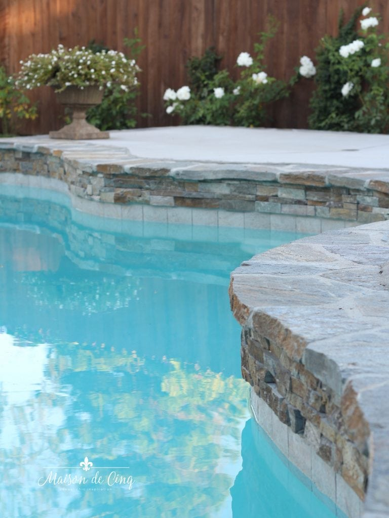 pool coping and water line tile flagstone