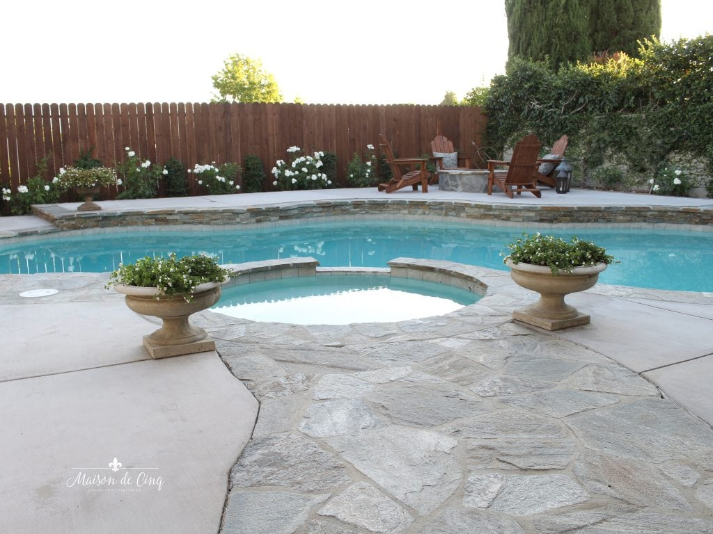 backyard pool renovation reveal with fire pit