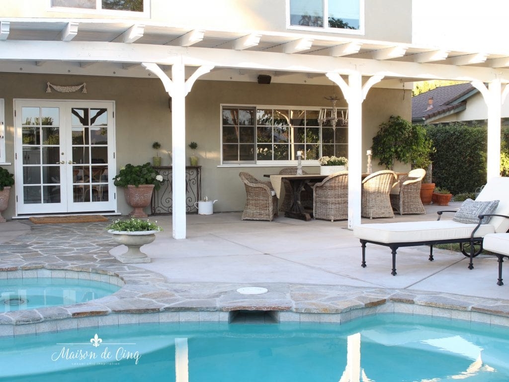 pool and patio area gorgeous backyard renovation flagstone wicker chairs farmhouse table