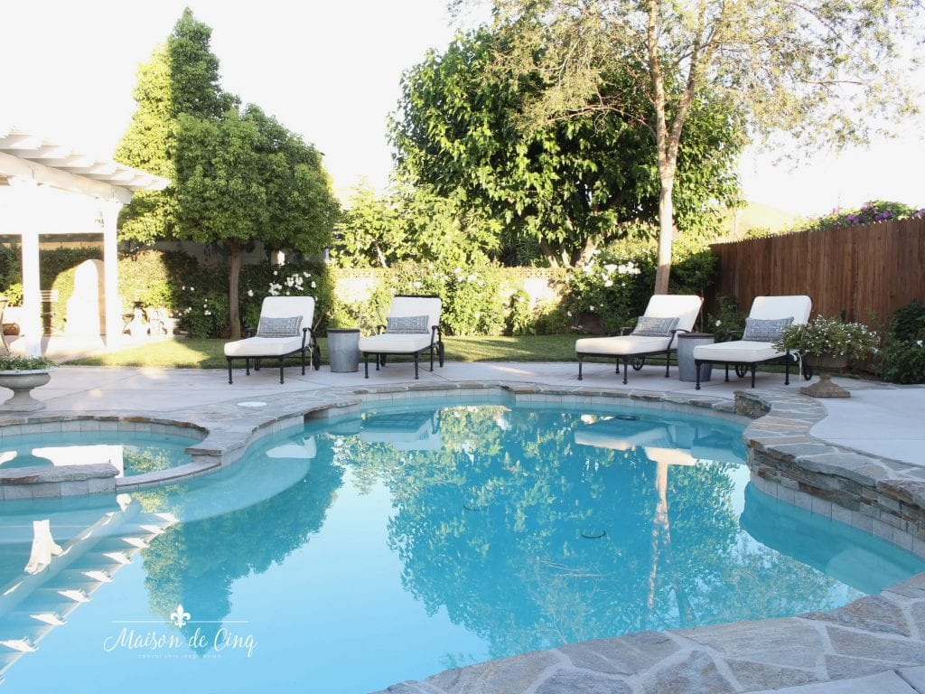 gorgeous outdoor pool and yard with flagstone trim