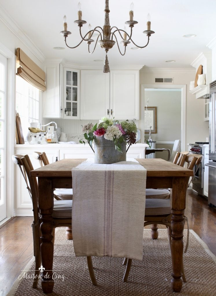 top ten posts of 2020 gorgeous French country dining area chandelier farmhouse table white kitchen