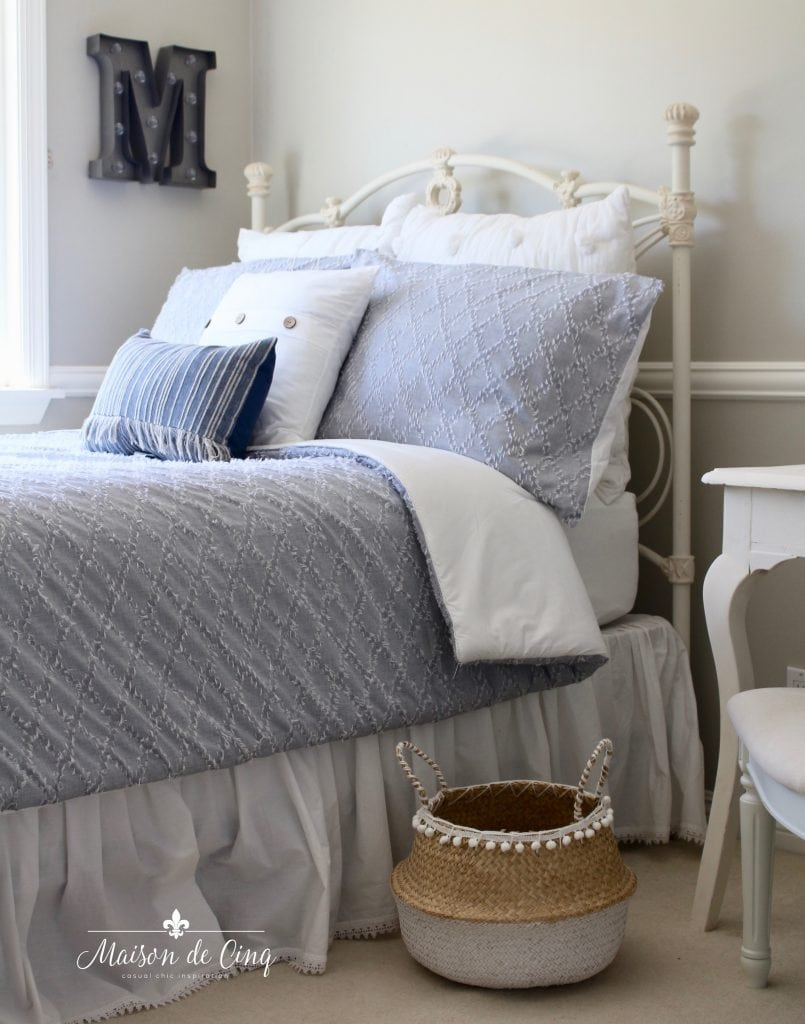 coastal teen bedroom refresh makeover blue and white bedding adorable white vintage iron bed