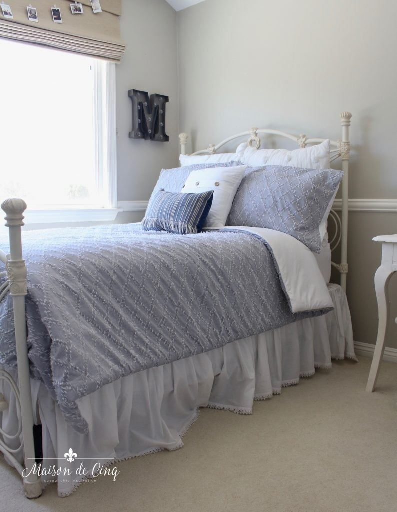 coastal teen bedroom refresh pale blue comforter white pillows white iron bed