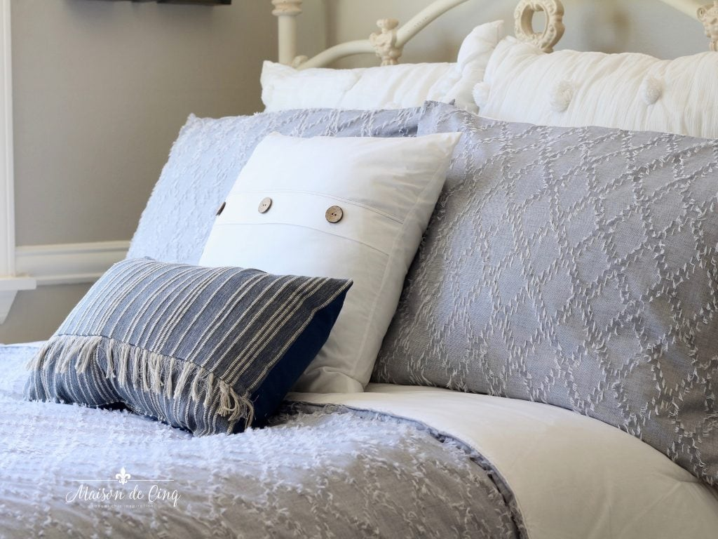 coastal bedroom details blue bedding and pillows grey walls