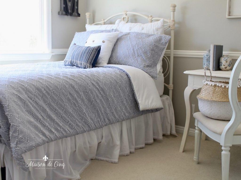 coastal teen bedroom refresh blue and white bedding grey walls neutral bedroom