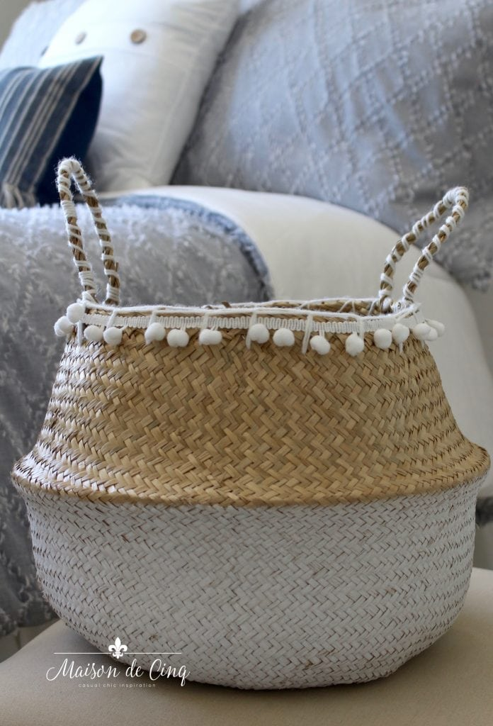 cute seagrass basket with pom poms coastal bedroom makeover