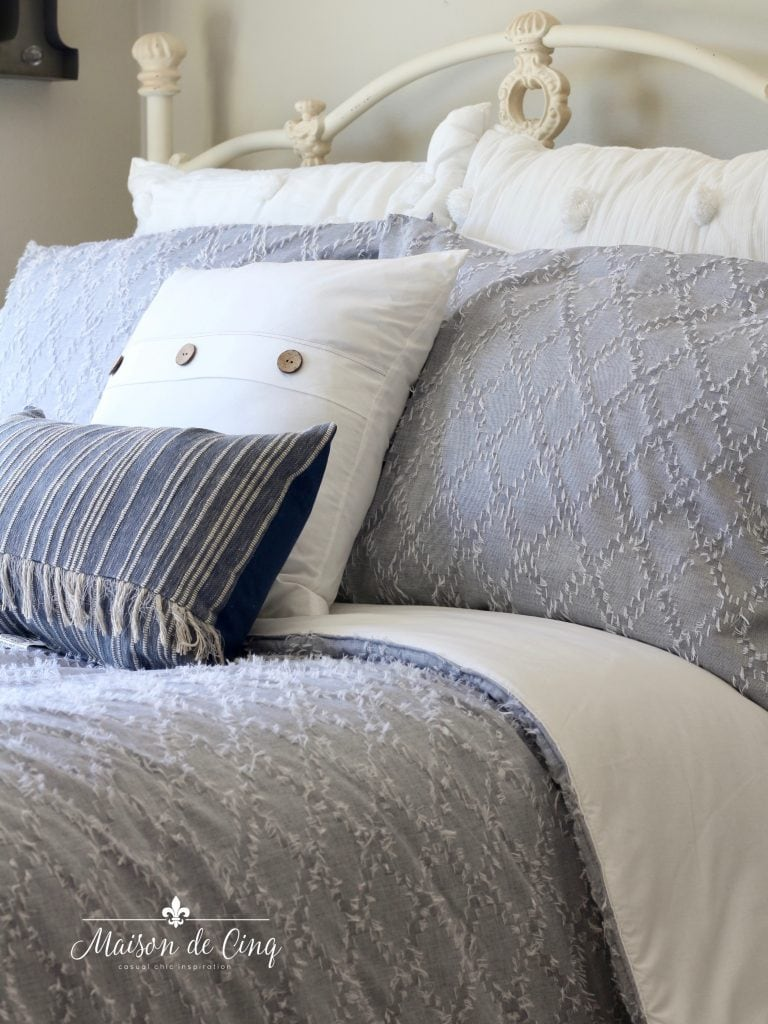 gorgeous coastal bedroom refresh pale blue chambray pillows and comforter