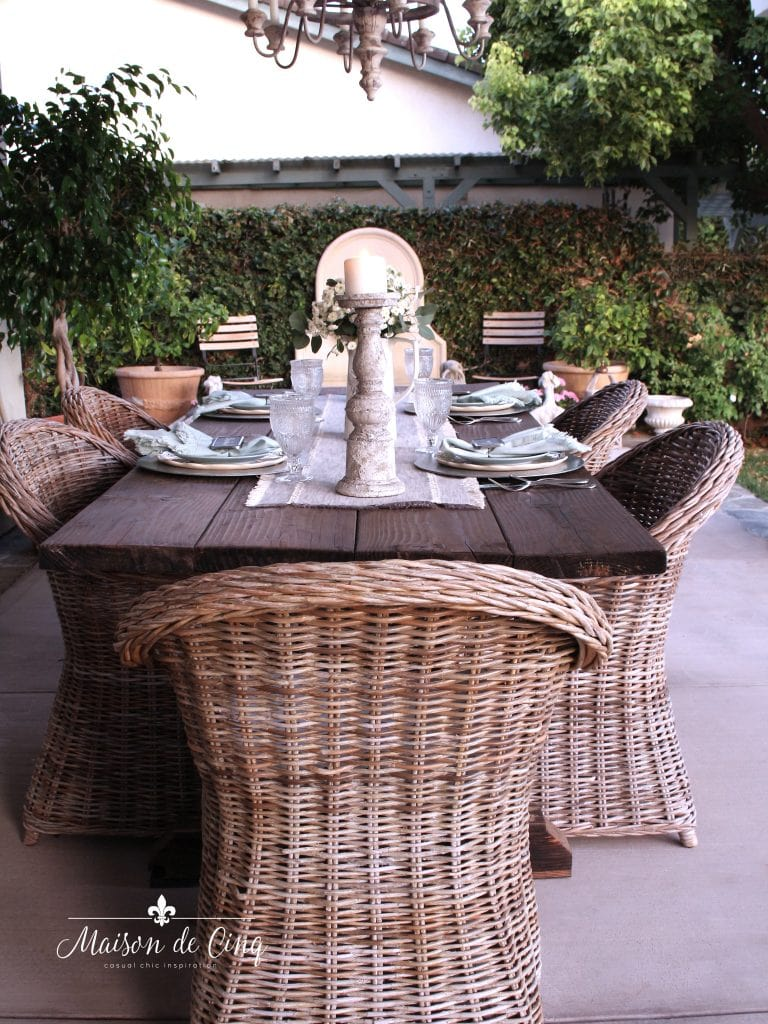 simple farmhouse table setting perfect for summer outdoor entertaining farmhouse table wicker chairs