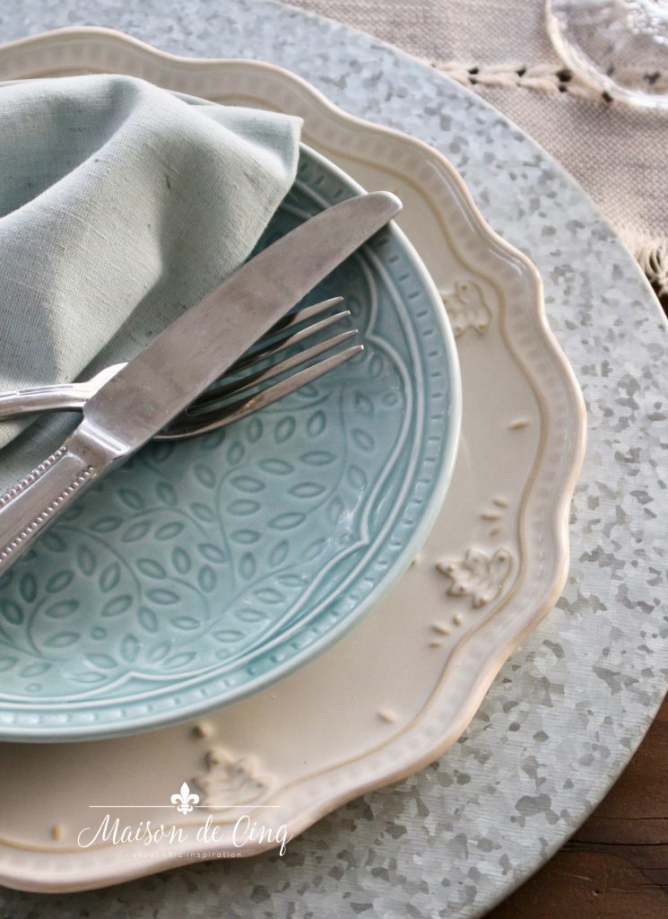 blue salad plate over white dinner plate and galvanized metal charger farmhouse style table decor