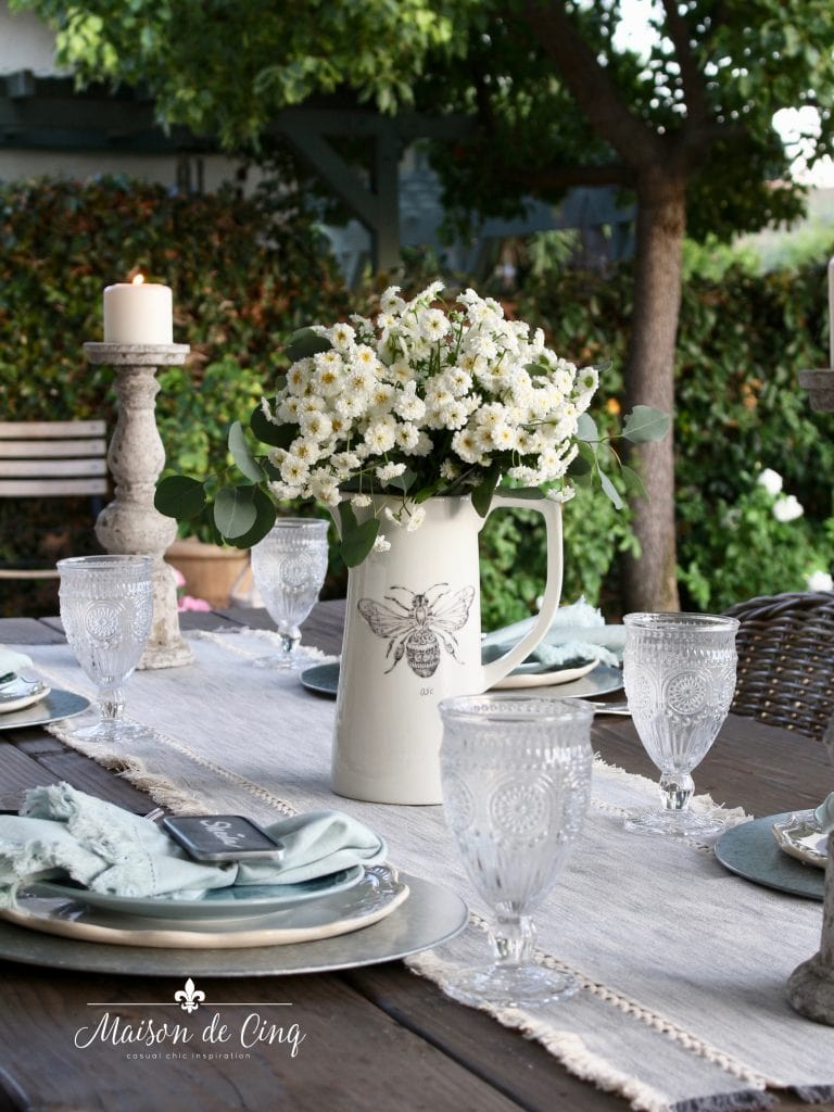 gorgeous simple farmhouse table setting summer tablescape in blues and greys with white flowers