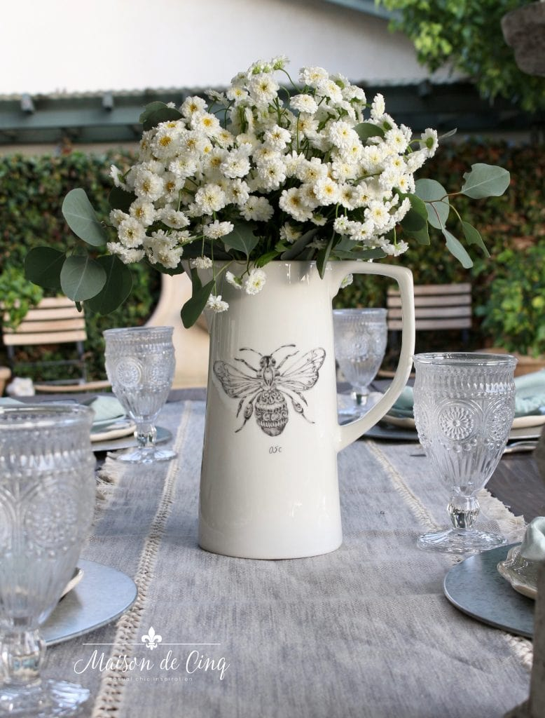 farmhouse table decor white flowers in bee pitcher grey runner outdoor dining