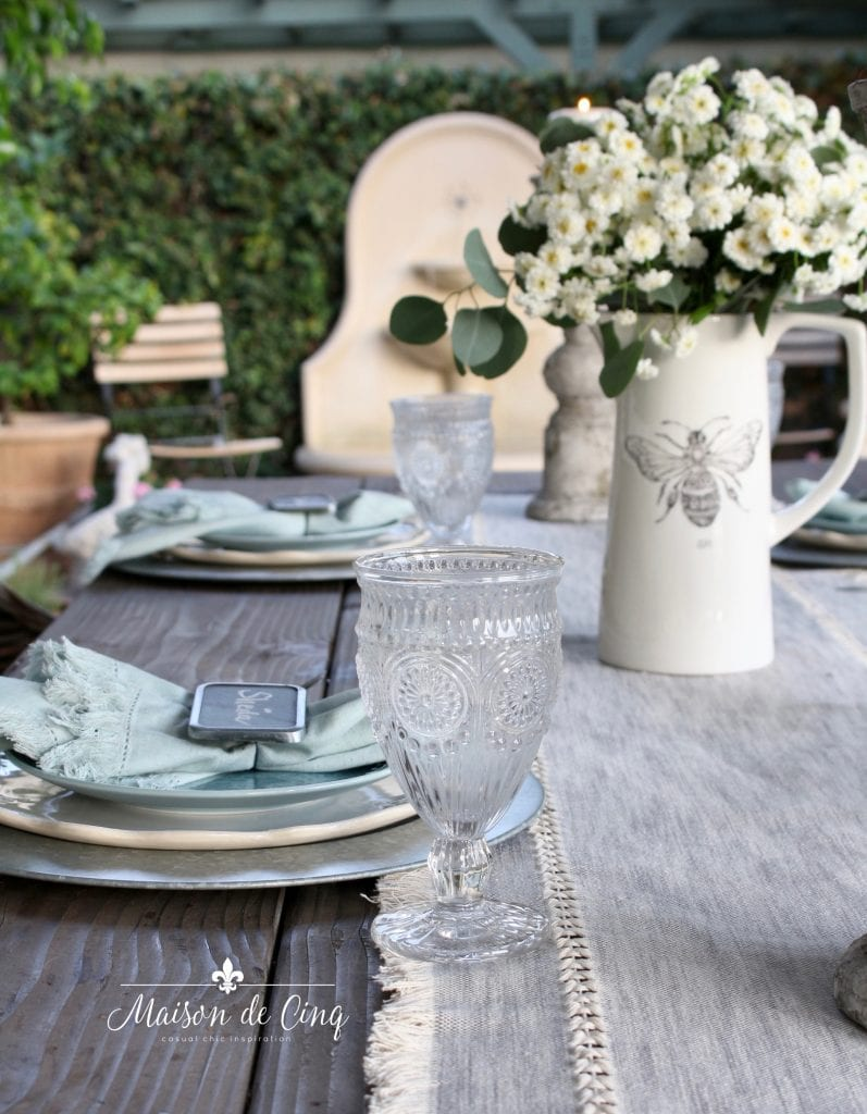 gorgeous outdoor summer table setting with soft blues and greys white flowers