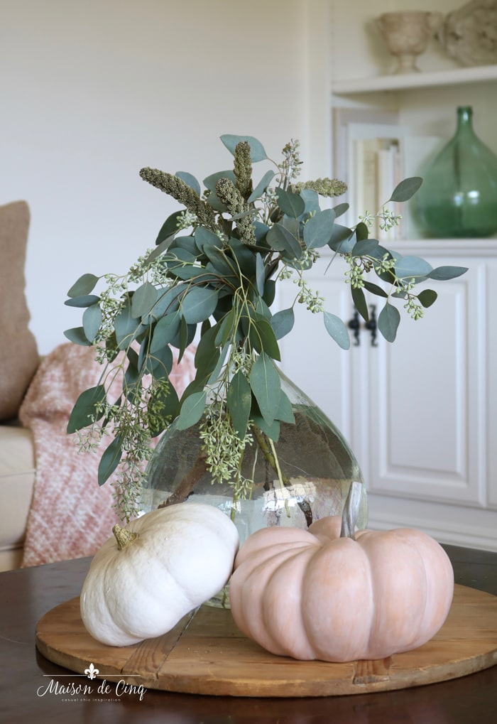 subtle fall decorating with whit and cinderella pumpkins eucalyptus soft green and blush