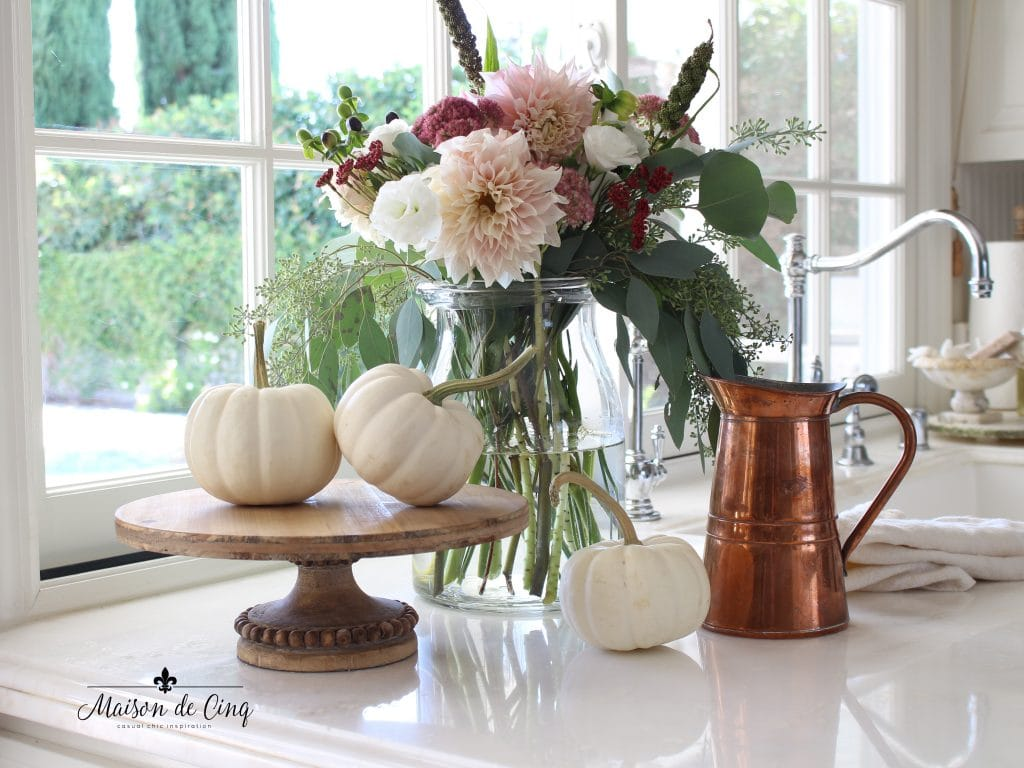 fall flowers in white kitchen with copper pitcher and white pumpkins