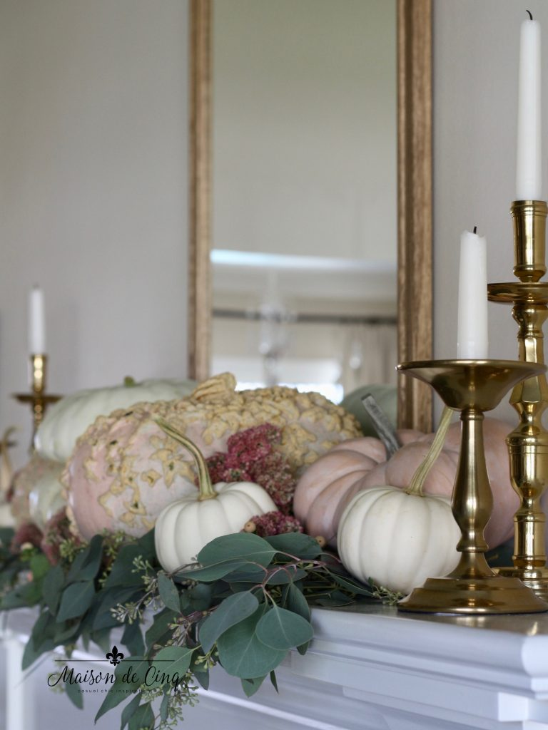 romantic fall mantel with pink and white pumpkins eucalyptus and brass candlesticks