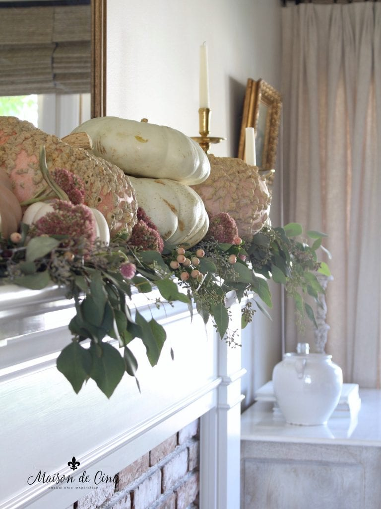 romantic fall mantel with pink pumpkins flowers and eucalyptus in gorgeous french country living room