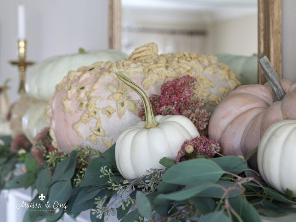 gorgeous autumn mantel decor with white and pink pumpkins and brass candleholders