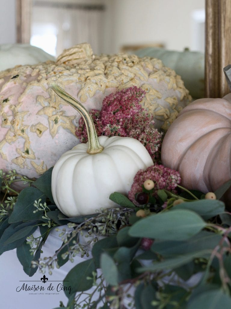 fall autumn mantelscape with pink pumpkins flowers and eucalyptus