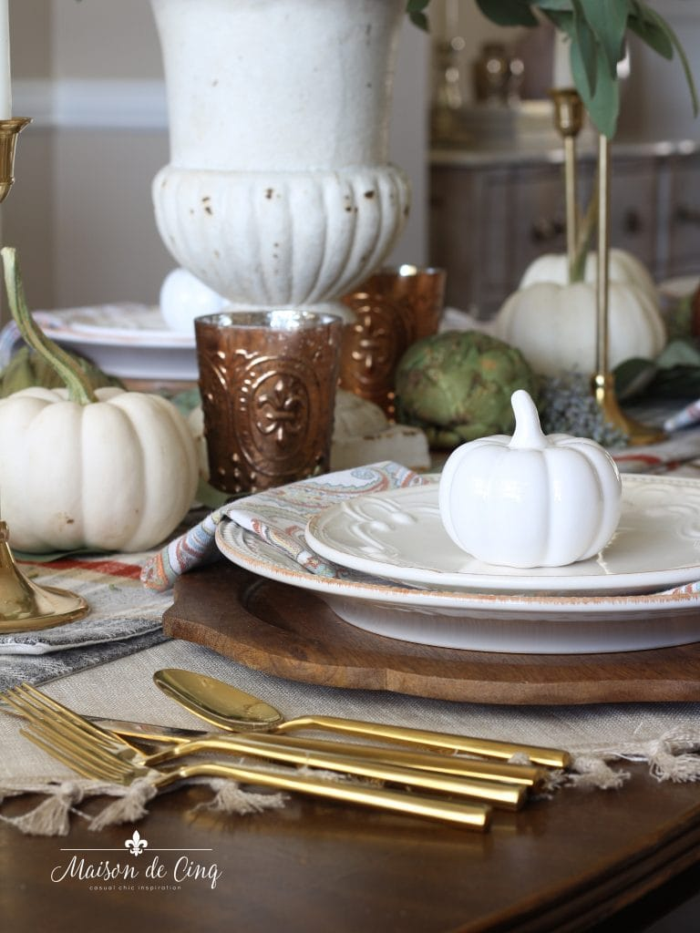 gold flatware on fall table setting with white plates copper votives and pumpkins