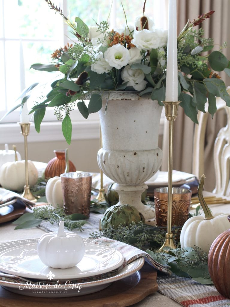 rustic autumn tablescape with french urn copper votives and brass candlesticks