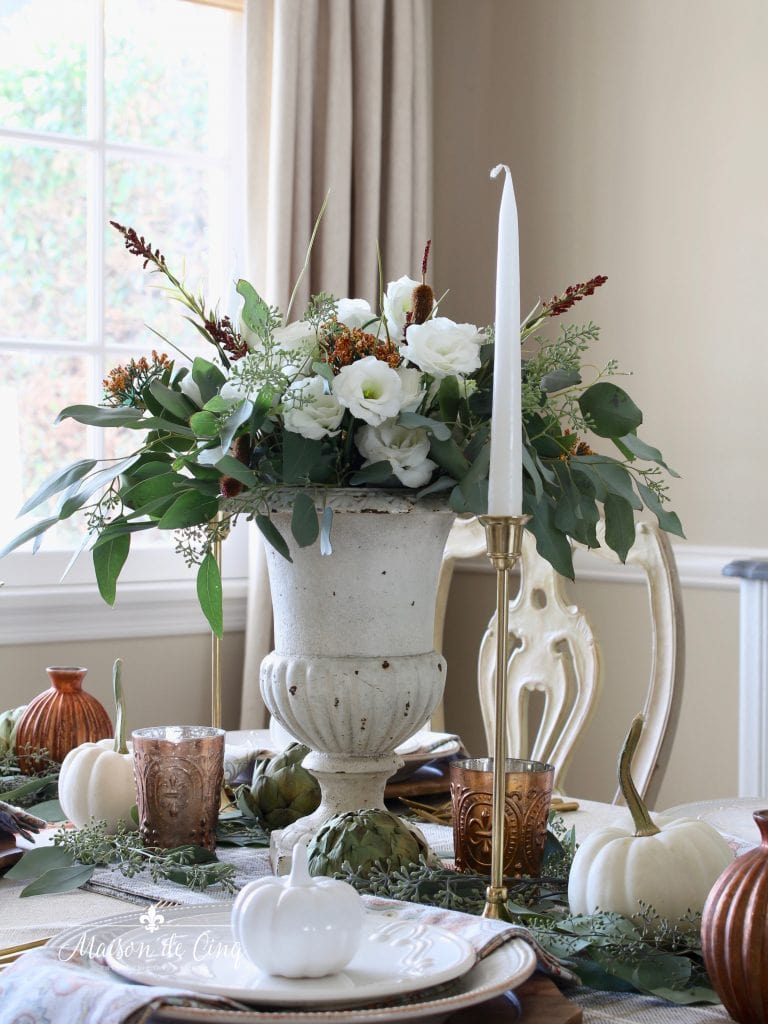 autumn tablescape with white and rust flowers in vintage urn French country style
